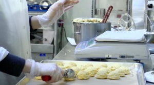 A food scientist at Hampton Creek Foods tests how plant-based egg alternatives function in baked goods. Video still courtesy of TechCrunch.