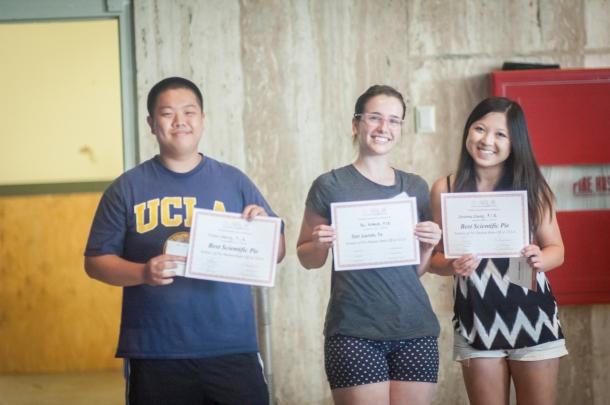 Christina Cheung, Tori Schmitt, and Elliot Cheung accept their awards for Best Scientific Pie