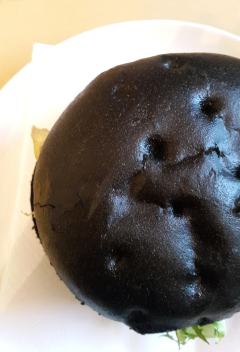 Black charcoal bread. (Image Credit: Emnamizouni/Wikimedia Commons)